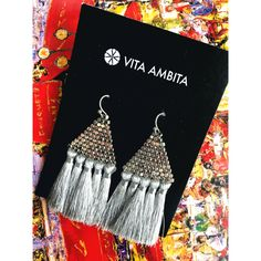 "Beautiful and on trend Grey and Rhodium Metal and Nickel compliant Beaded triangle Tassel fringe earrings. Fish Hook Back. Size 2"" x 2.5""      
