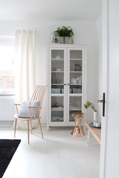 I have and love this cabinet (ikea Hemnes glass panel) It's about time to buy a second one, though - mine is stuffed with books and can't hold anything else! Glass Cabinet Doors, White Cabinet, Glass Door, Interior Architecture, Interior Design, Hemnes, Living Spaces, Living Room, Inspired Homes