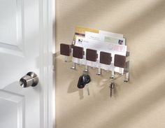 Key and mail rack helps the family keep track of keys in one central spot which also holds important mail items. It's the perfect size, sturdy and modern style which allows it to go with any wall color or style in your home.