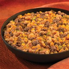 You'll be rewarded with smiles when you make this quick-cooking skillet dish that mixes seasoned ground beef, corn and pasta in a cheesy tomato sauce. It's sure to become a family favorite.