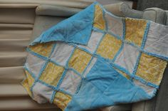 rag quilt I made from yellow and white flannel and blue minky