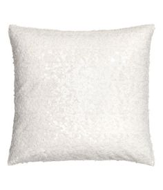 White. Cushion cover with a sequined front section, woven cotton back section, and a concealed zip.