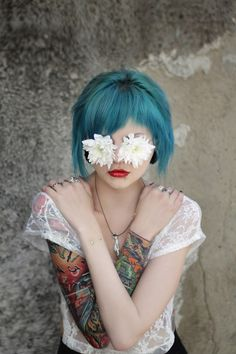 Piercings. Tattoos. Flowers and Hair. Love it all.