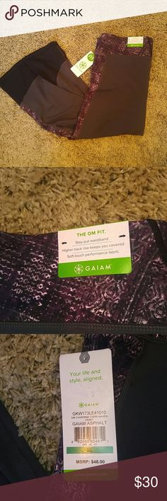 """Size XL Gaiam yoga pant. Gaiam capri yoga pant. Gray with purple pattern and black around the end of the leg. """"The om fit"""" featuring stay out waist band and a higher back to keep you covered while moving. Gaiam Pants"""