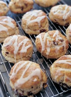 Barefoot Contessa - Recipes - Cranberry Orange Scones - I prefer to use lemon juice rather than orange and I substitute dried blueberries instead of cranberries.  I do the egg wash on top and sprinkle sugar on before baking, instead of frosting.  These are yummy!