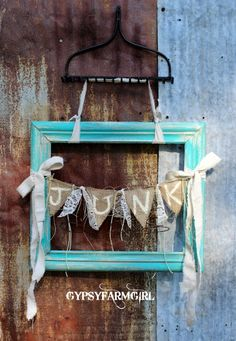 Junk frame hung from a rake.  Adorable ! (from GypsyFarmGirl)