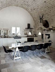 Curved ceiling is really cool. It's not a real kitchen without taxidermy