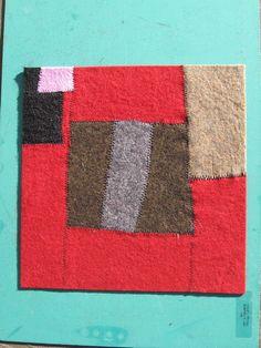 http://wildonionstudio.wordpress.com/2007/12/05/wool-felt-quilt-blocks/