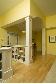 Don't care for the wall color, but I love the bookshelves and arch way ceiling. From Houzz.com.