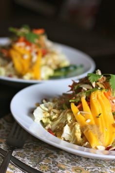 Thai Crunch Salad - carrots, jicama, snap peas, cabbage, cucumber, mango, almonds, hazelnuts, chicken, cilantro