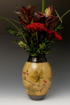 Small amber vase red berries