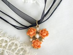 Pretty Vintage Peach Roses Pendant on a Black Ribbon Cord Necklace. $7.50, via Etsy.