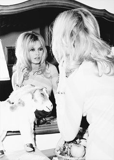 normajeanebaker:  Brigitte Bardot checks her appearance in mirror at the Plaza Hotel, 1965