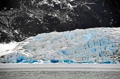 Klas Stolpe / Juneau Empire-The deep blue of freshly exposed ice can be seen at the terminus of the Mendenhall Glacier on Thursday. Laurie Craig, lead naturalist at the Mendenhall Glacier Visitor Center, said she didn't witness the calving event that happened on Wednesday, but it was captured on video by cameras at the center.
