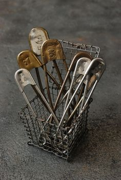 Large Vintage Safety Pins...in an old tiny wire basket.