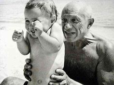 1951 Robert Capa - Picasso and son