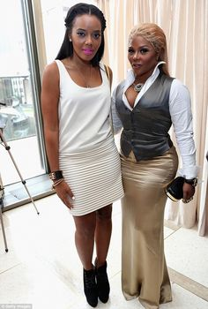 www.CelebrityInTraining.com  Contrast: The 24-year-old reality star looked chic in her white dress with pleated skirt while rapper Lil' Kim needed to iron her Ralph Lauren ensemble