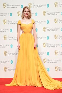 18 Smoking Looks From The BAFTAs Red Carpet #refinery29 http://www.refinery29.com/2015/02/81971/bafta-awards-2015-red-carpet-best-dressed#slide-7 Lea Seydoux Not many of us can pull off canary-yellow plus cut-outs, but Lea Seydoux looks smoking here in Prada. Her coiffed hair frames her face perfectly and emphasises the elegance of the whole look.