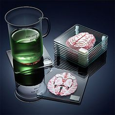 This set of coasters with brain slices forms a full brain that you can look into when stacked on top of one another. Nerd out over a cocktail with your brainy friends while you protect your table. Table Coasters, Glass Coasters, Drink Coasters, Niklas, Drink Table, Gothic House, Gothic Mansion, Coaster Set, Coaster Design