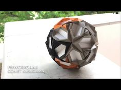 Use 30 square sheets of origami paper. Difficulty : ⭐⭐⭐ Time: 2 hours Falling star on the ball. Model paper size: Unit (brown, gray, black) : cm x cm. Origami And Kirigami, Origami Paper Art, Paper Crafts, True Wallet, Origami Diagrams, Modular Origami, Falling Stars, Paper Stars, Origami Tutorial