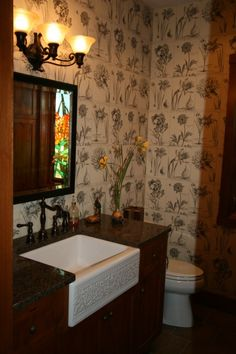 Love the farmhouse style sink and the wallpaper!!