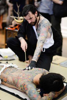 Live tattoo performance by Horiyoshi III's apprentice Alex 'Horikitsune' Reinke on Daisuke Sakaguchi., Photo © David Jensen