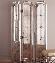 folding mirror screen great for privacy, enlarging a space and to reflect light.