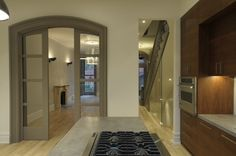 Choose a soft gray or beige on your doors and trims for a dramatic look that still feels light and airy.