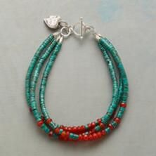 You'll love the vibrant colors and darling heart charm dangling from this sterling silver turquoise bracelet.