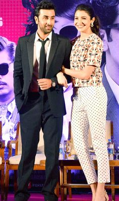 Ranbir Kapoor and Anushka Sharma strike a pose for the shutterbugs at the second trailer launch of their film 'Bombay Velvet'. Bollywood Couples, Bollywood Photos, Bollywood Stars, Bollywood Celebrities, Bollywood Fashion, India Fashion, Asian Fashion, Girl Fashion, Fashion Outfits