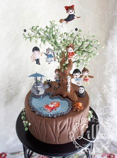 Hayao Miyazaki's Studio Ghibli-themed cake with characters from many movies. Kikki's Delivery Service, My Neighbor Totoro, Spirited Away, Ponyo, Princess Mononoke.
