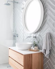 Grey herringbone subway tile on modern bathroom with floating vanity, white vessel sink and round mirror bathroom Minimalist Bathroom Design, Simple Bathroom Designs, Modern Bathroom Design, Bathroom Interior Design, Decor Interior Design, Modern Minimalist, Modern Bathroom Sink, Interior Ideas, Modern Bathrooms