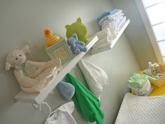 hooks above changing table to put clothes out for the next changing...