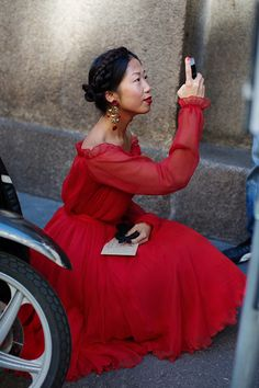 I need to get a red dress! This whole look has a 19th century feel! Very English period drama but in bold colors!