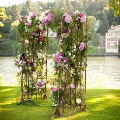 """Cecily and George  The lake surrounding Waverley Country Club was the perfect backdrop for Cecily and George's ceremony. This wedding arch is one of a kind. The florist tied bunches of flowers in pink shades around the arch to create a magical place for the couple to say """"I do"""".  Florist: Crystal Lilies Image Credit: Altura Studio"""