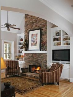 FAVORITE MIGHT LIKE A TALLER HEARTH AND ARCHED FIREPLACE OPENING WITH A RUSTIC WOOD OR STONE MANTEL stone fireplace