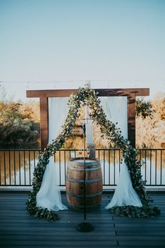 Add a touch of you to your ceremony. The arch is a perfect way to incorporate your theme into your wedding.  #archdetails #archdecor #ceremonydecor #archinspiration #ceremonyinspo #thewindmillwinery #weddingdecor #weddingvenue #lakewedding #arizonawedding