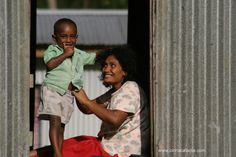 Motherly love translates into any language.  This was taken in a village at the top of a remote mountain in Fiji.