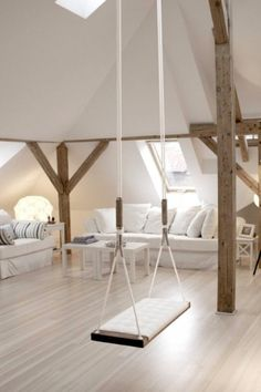 The dream home everybody wants: Who doesn't want a serene attic with exposed beams and soft white sofas to escape to.