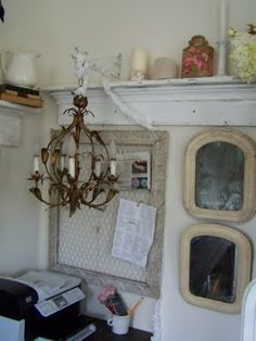 Chicken wire frame.  Love the shelf too...