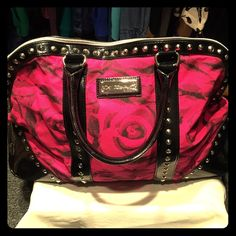 Betsey Johnson overnight bag Betsey Johnson overnight/travel bag. Hot pink and black, abstract rose print. Lightly used and in great condition minus a scratch on the bottom of the bag (pictured). Perfect for any quick overnight getaway. Betsey Johnson Bags Travel Bags