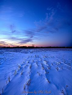 Azure sky over a snowy field