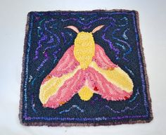 Check out this item in my Etsy shop https://www.etsy.com/listing/497857427/rosy-maple-moth-hooked-table-mat-or-wall
