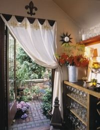 This Portiere Makes A Soft Frame For An Enchanting Patio Garden.