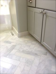3x12 Herringbone marble bathroom floors. Saw this in a recent new build, and it was stunning!