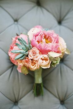 Coral-colored flowers mix perfectly with succulents | Brides.com