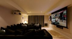 Artcoustic Home Cinema featuring 3 x DF75-55 LCR with drop down cinema screen, installed by Audiovation - 8