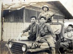 North Vietnamese Army soldiers with a captured U.S. military jeep. One of the men holds up a captured M16 assault rifle.