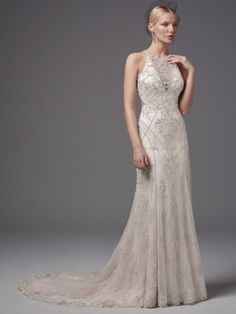 Sottero and Midgley - FELICIA, Shimmering beaded lace appliqués and crosshatching add luster and dimension to this glamorous sheath, highlighting the waistline, illusion halter over V-neck, and illusion open back. Embellished lace hem completes the gown's striking lines. Finished with crystal buttons over zipper closure.