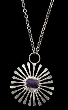 """JACOB HULL SILVER PLATED """"STARBURST ATOMIC"""" PENDANT Danish, Circa 1970 <br /> Made for Buch and Deichmann. Set with a central amethyst. Stamped on reverse """"J. Hull"""", """"B"""